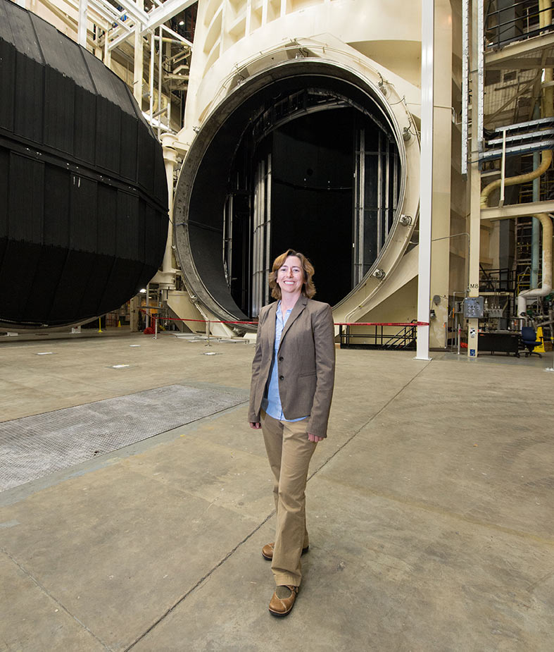Liz Warren stands in front of the Vacuum Chamber