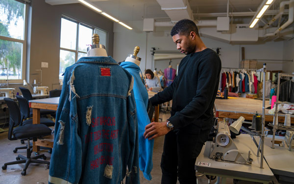 student taking part in a fashion class - UC Davis transfer admit rate
