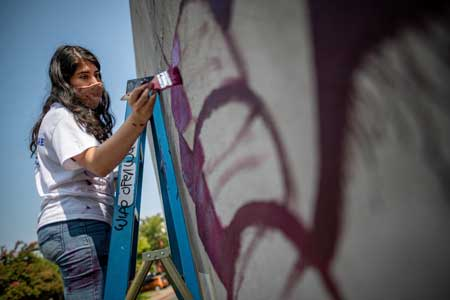 Artist paints mural