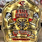 "Gold fire helmet shield reads ""Fire Chief / UC Davis / Trauernicht"""