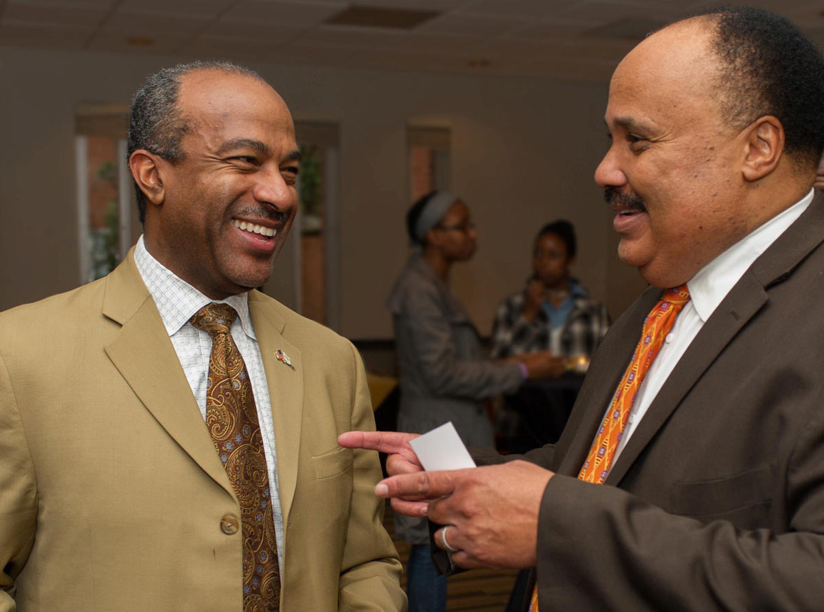 Gary S. May and Martin Luther King III, chatting