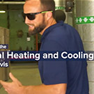 """Man walks with text """"heating and cooling"""" superimposed"""