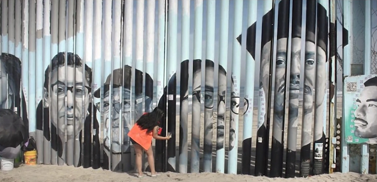 Woman paints a mural