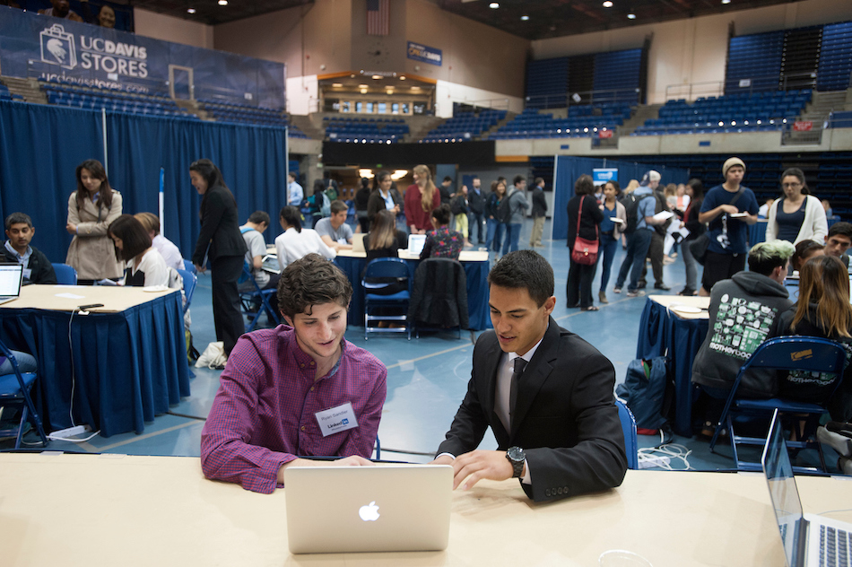 A student talks with an advisor in a conference.