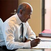Chancellor May Writing at Desk