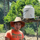 farmer in Guatemala next to irrigation tank