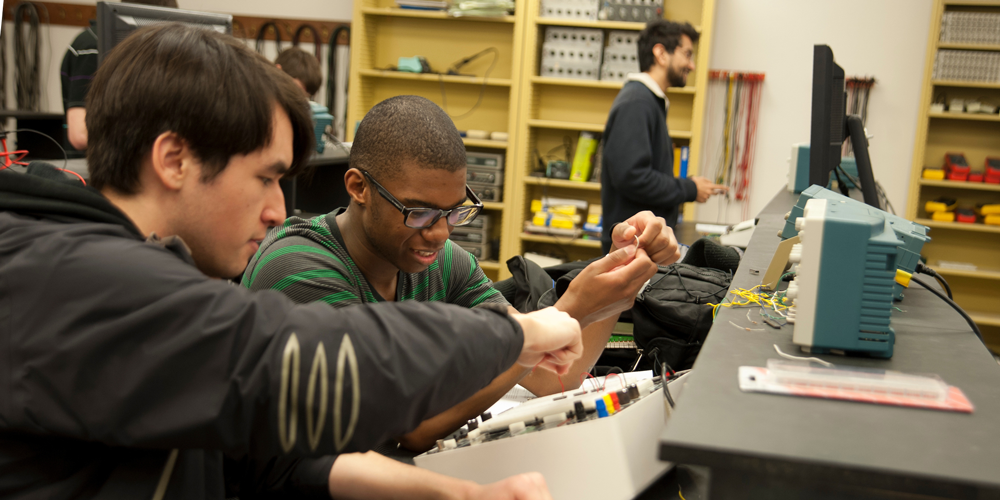 Two students working on an electrical project in physics class in the college of letters and science