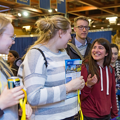 student talking with a campus tour leader at discover uc davis