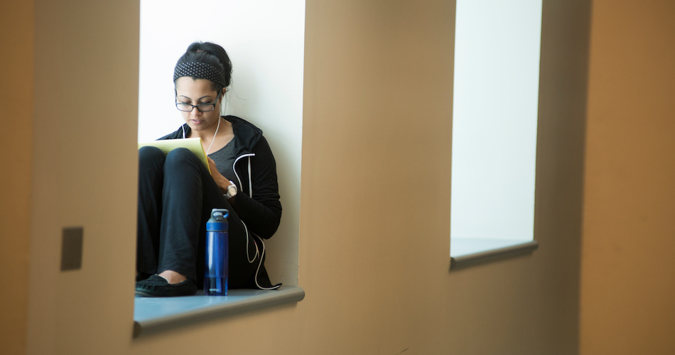 Caption/Description: UC Davis student studies on the second floor of Shields Library.
