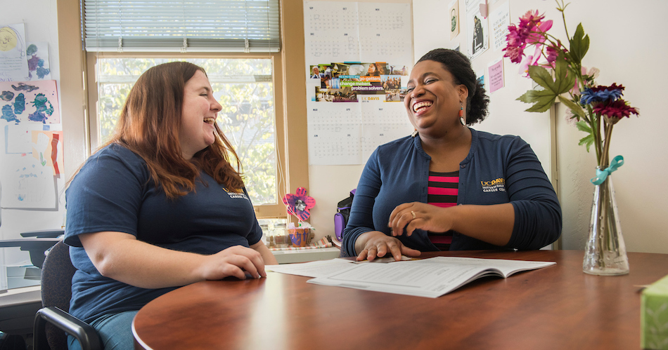 Ashley Jess, a Forensics Graduate Student chats with career advisor Marjannie Akintunde, in her office in South Hall. Akintunde earned her PhD from UC Davis and now works as a career advisor for master's, Ph.D. and postdoctoral scholars. (Karin Higgins/UC Davis)