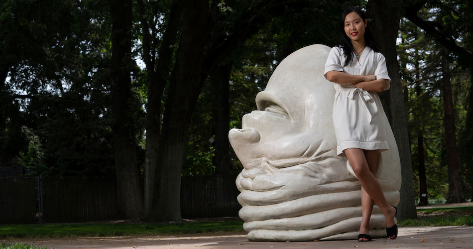 "Recent graduate, Daisy He photographed at the ""Eye on Mrak"" egghead near Mrak Hall. He is a former Student Assistant to the Chancellor. She is an international student from China who majored in Psychology and Econmics. (Karin Higgins/UC Davis)"
