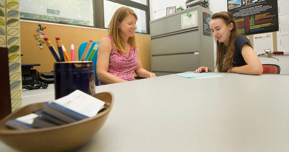 Julie McGilvray, Undergraduate Advisor for the Arts meet with Devon Bradshaw, a double major in Music and Statistics.