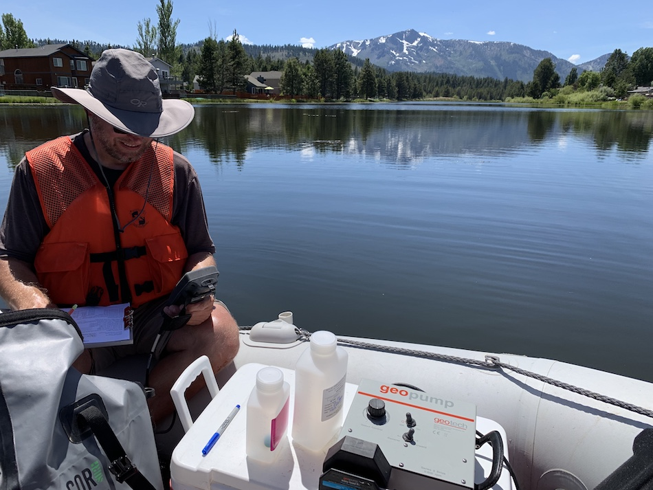 An environmental planner conducts water sampling.