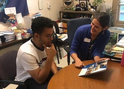 Hesham Ahmed is a senior transfer student studying Managerial Economics. He is also a Reception Intake Intern at the Internship and Career Center.  Here he is talking with Lynn Fowler, Senior Career Advisor about the Career Resource Manual.  Picture by Adriane Boykin, ICC, UCD.