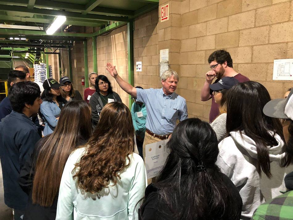 Students on the Western Growers Trek to the Imperial Valley learning about agriculture careers, meeting with Alumni Franz De Klotz, Vice President at Richard Bagdasarian and UCD Alumni.  Photo courtesy of Lynn Fowler, Career Advisor, UCD.