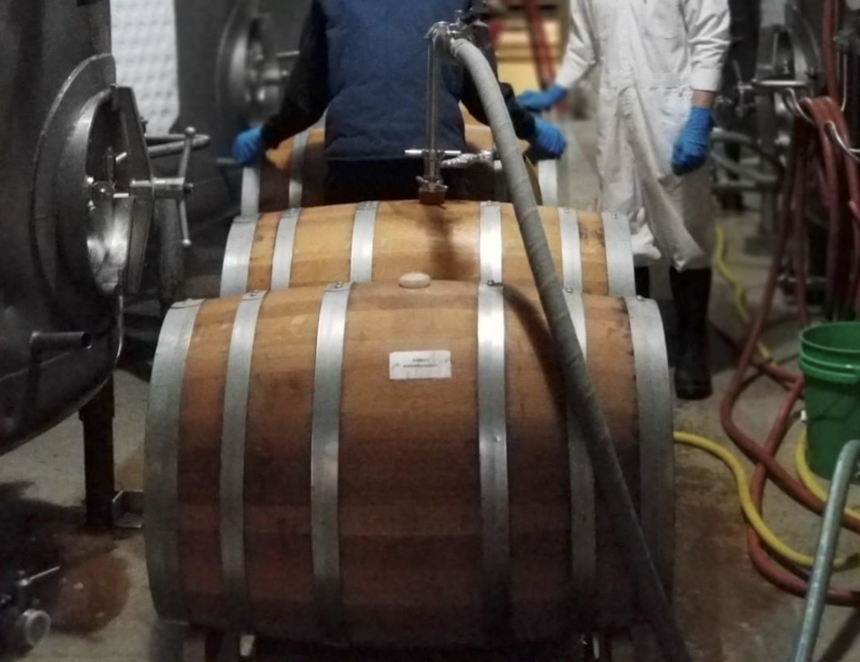 Ben Carignan (left) and colleague rinsing barrels and racking Anchor Porter aged in whiskey barrels. (Photo courtesy of Anchor Brewing Company)