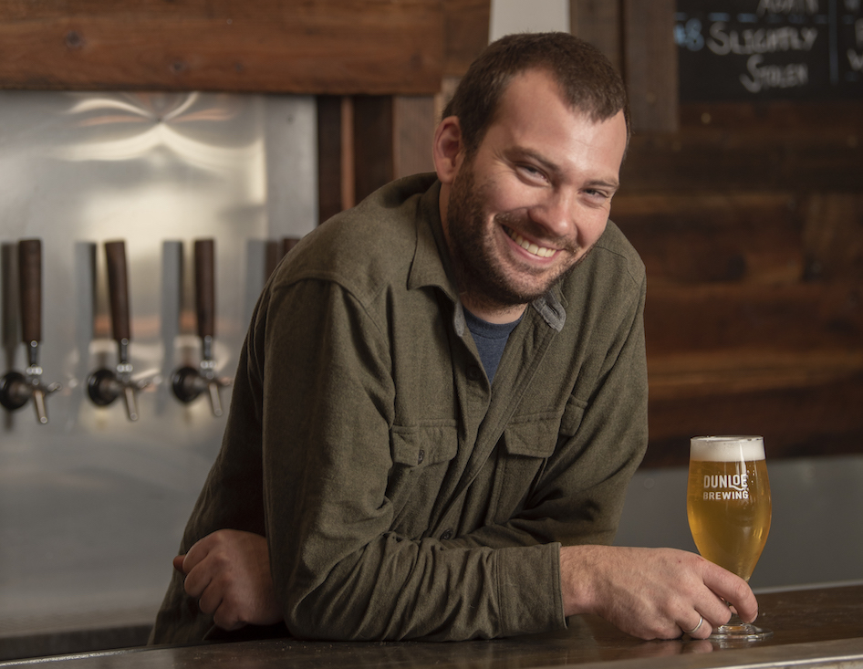 Brennan Fleming, photographed inside his Davis brewery, Dunloe Brewing. (Karin Higgins/UC Davis)