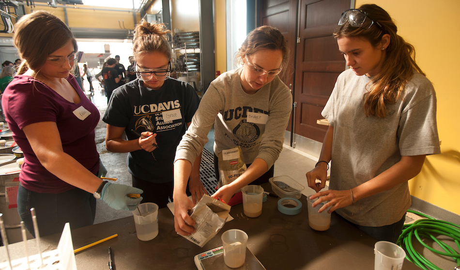 (l to r) Kelly Gifford, Grace Sayre, Bridget McLoughlin (Viticulture and Enoloy majors) and Jill Bilodeaux, a biotechnology major, work to record and make their varied yeast mixtures during grape crush class in the winery at Robert Mondavi Institute on September 30, 2016 at UC Davis.  The goal of the class is to give students practical experience  in winemakeing on a small scale so that they can make errors on a small scale.