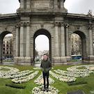 A student stands in front of a monument.