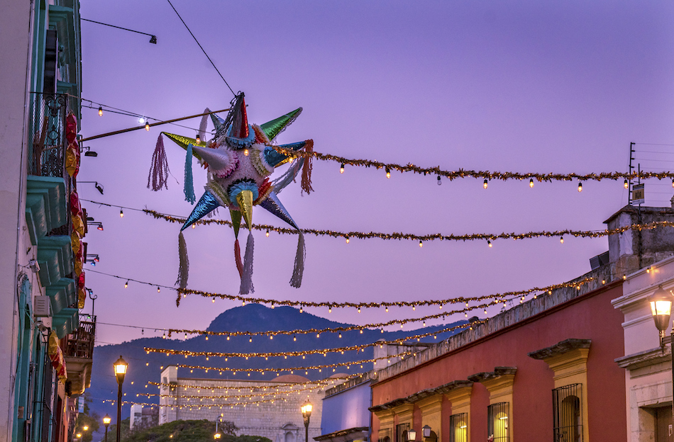 A Mexican skyline with decorations and a sparkling posada star