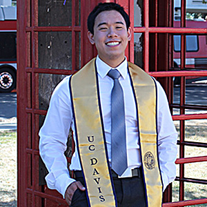 Communication major Chinsin Sim '14 next to a UC Davis phone booth