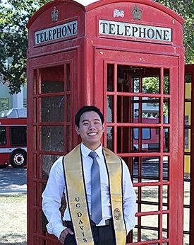 Communication major Chinsin Sim sitting on the UC Davis East Gate