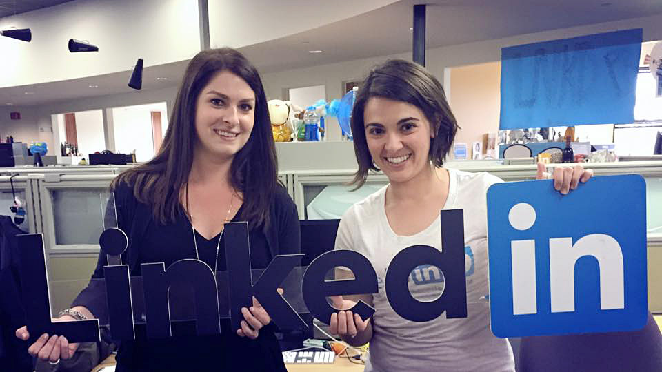 Emilia Varshavsky Shapiro, left, and colleague hold a LinkedIn sign