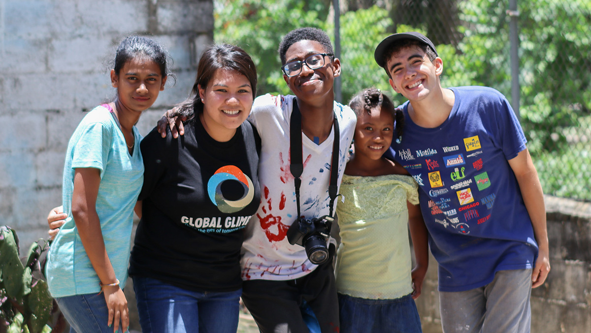 Four people on a Global Glimpse trip in Dominican Republic posing for a picture