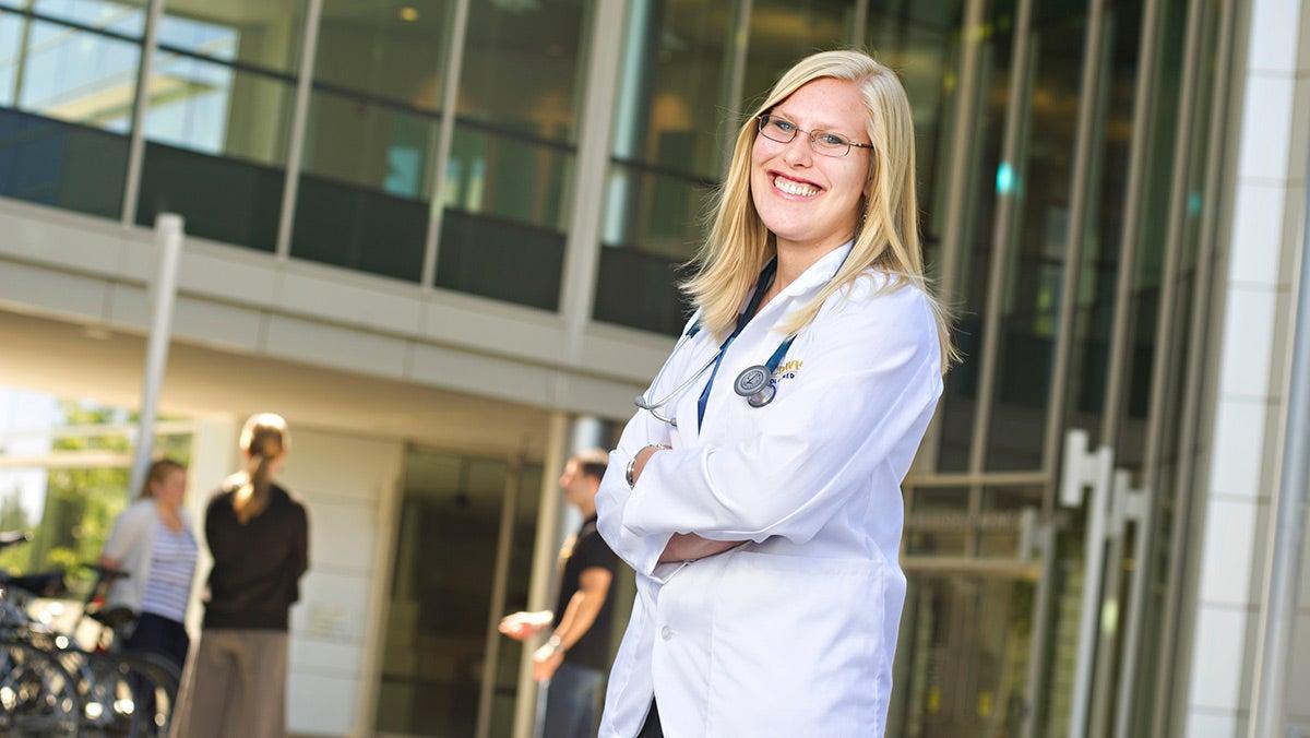 Alumna Kate Brown Richards in her doctor's coat