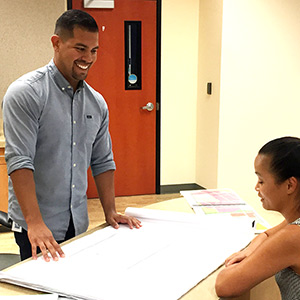 Community and regional development major Nick Sosa, left, working with a colleage in a city planning office