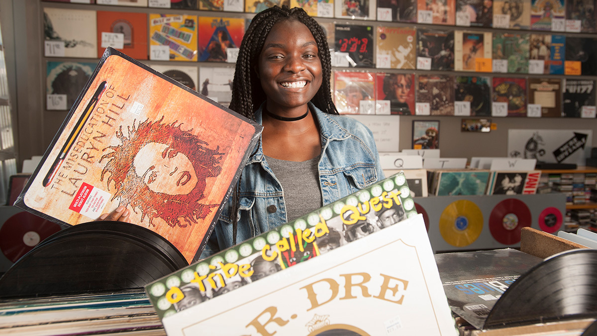 Amanda Eke, gender, sexuality and women's study major, in a music story showing hip hop records