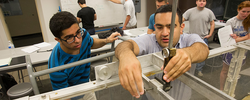 UC Davis civil and environmental engineering graduate student Kaveh Zamani, right, showing a student how to use an instrument