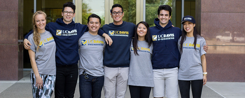 Several students in engineering T-shirts arm in arm