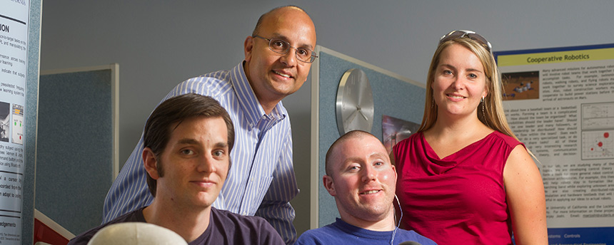 Mechanical and aeronautical engineering graduate student Kenneth Lyons, left, with professor Sanjay Joshi, lab volunteer Adam Shapiro and Maria Skavhaug