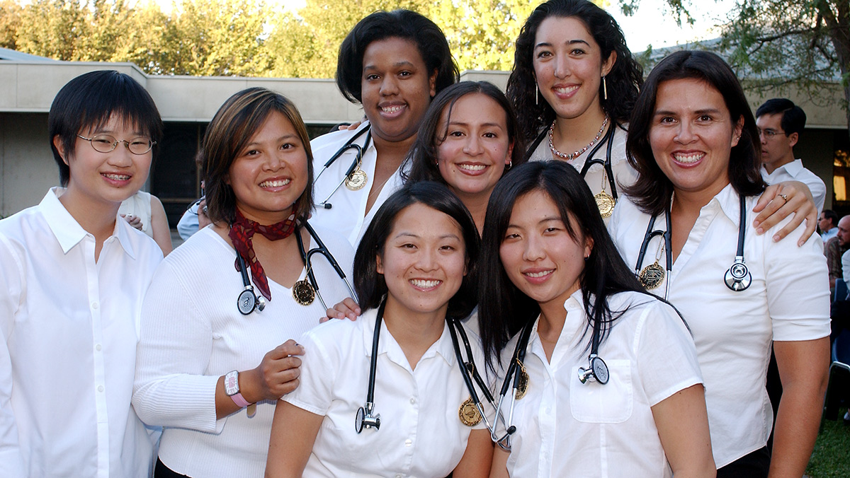 group of medical students from the Class of 2008 pose for their induction into the program