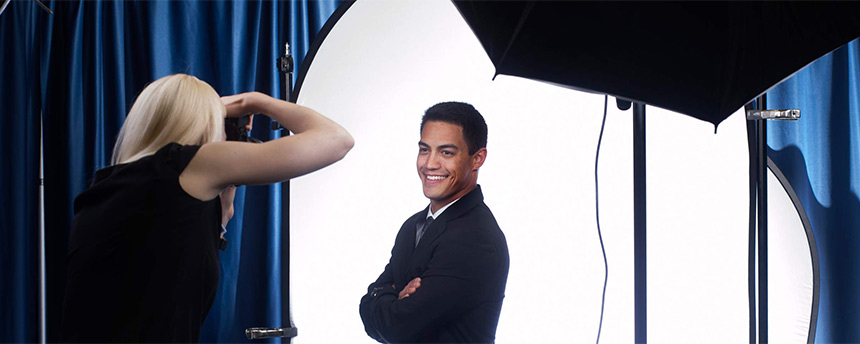 Man getting his photo taken in a professional photography setting