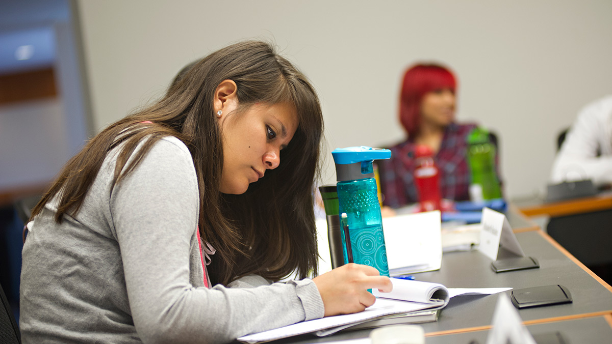 Haydee Gonzelez, a Spanish and political science major, works on school work at a table