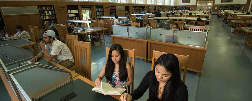 library reading room with students studying
