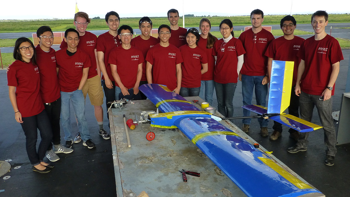 The 2016 UC Davis Advanced Modeling Aeronautics Team members and the aircraft they built