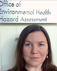 Elizabeth Marder standing under a sign that says Office of Environmental Health Hazard Assessment