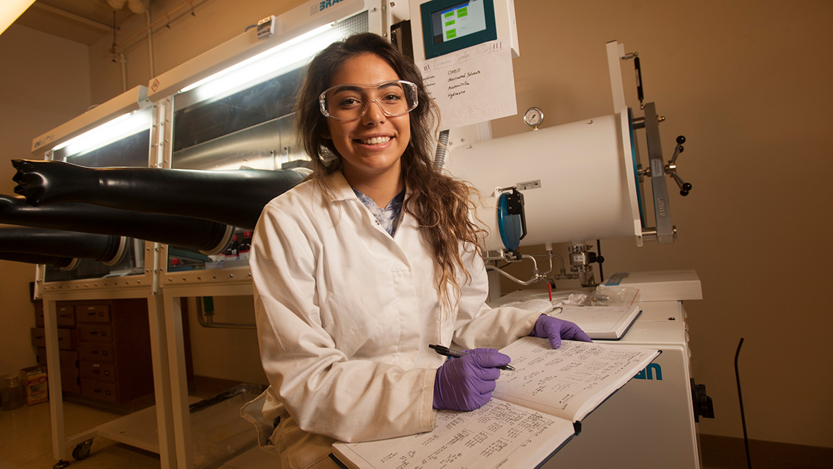 Pharmaceutical chemistry major Maia Yellowhorse working as an intern in Lisa Miller's lab