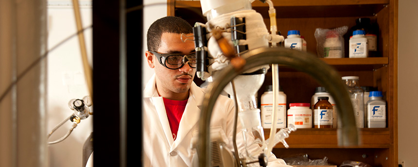Intern Manuel Munoz working in a chemistry lab
