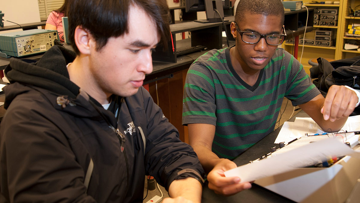 applied physics majors Chris Ducote and Breylong Tiley strong circuits together