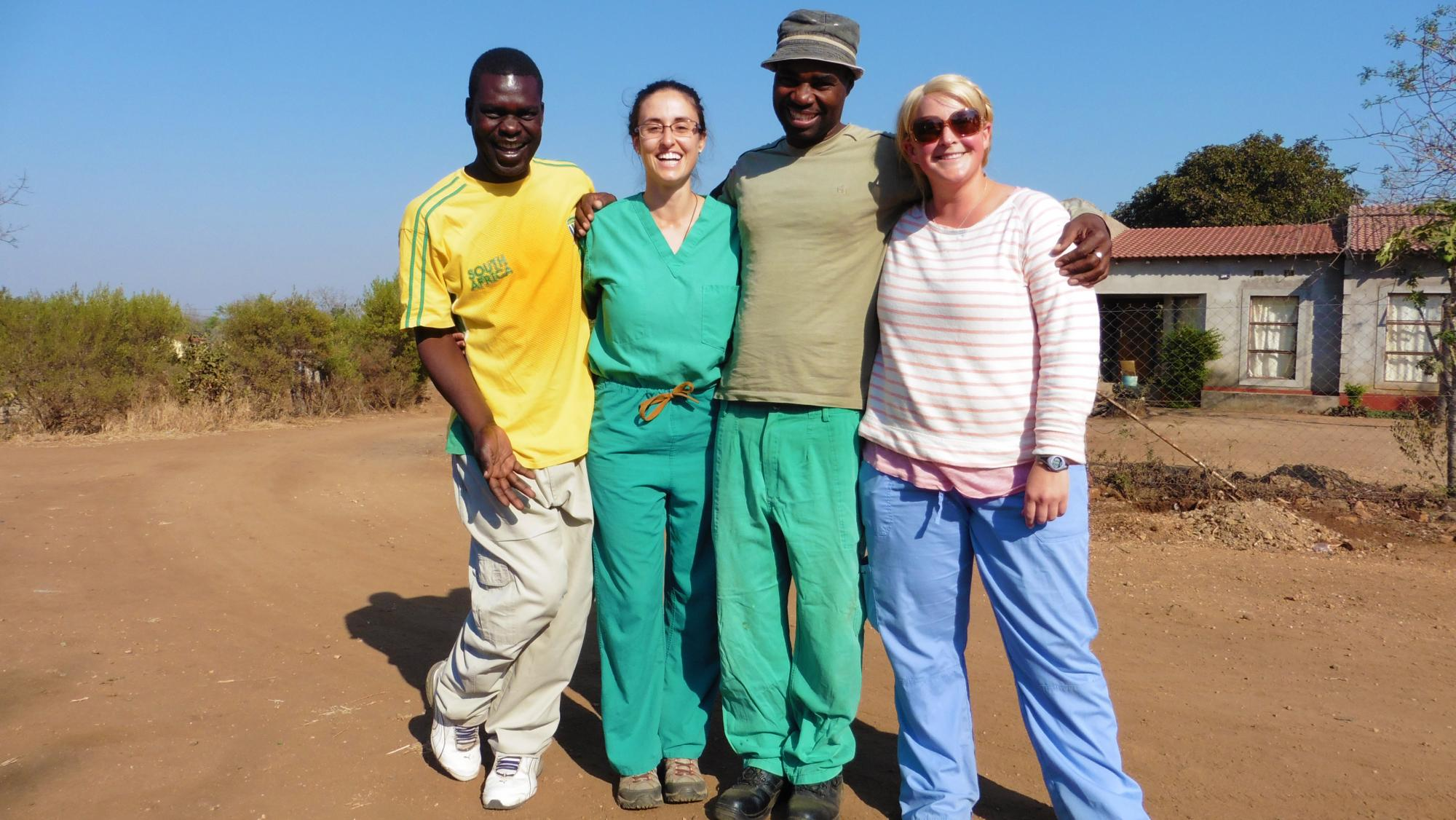 Two veterinary students with two local guides in South Africa.