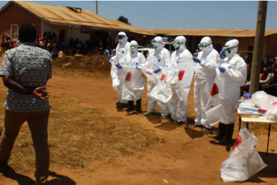 Health professionals donning proper personal protective equipment