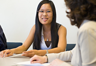 student talking with an adviser