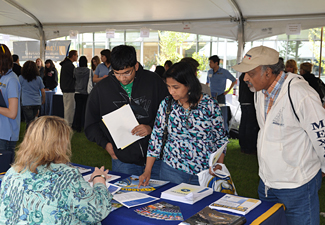 students and parents attending uc davis college fair