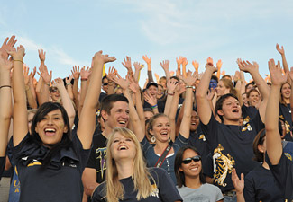 UC Davis students cheering at a game outside