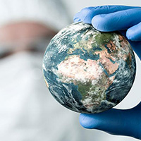 World in the hand of a health worker