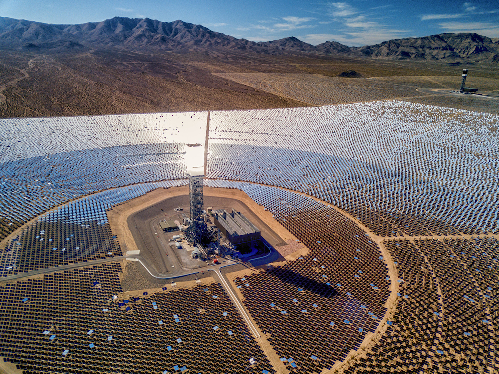 Aerial of large solar thermal energy plant in Mojave Desert